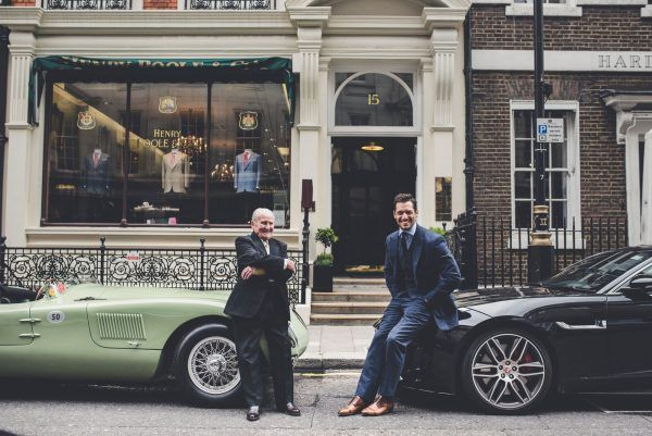 Norman Dewis OBE and David Gandy outside Henry Poole with E-type '77 RW' and F-TYPE SVR