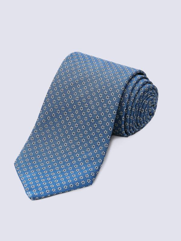 Tie Flower Ivory With Black Flower Centre On Light Blue Lr
