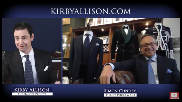 The perfect Zoom presentation: Simon Cundey's carefully chosen background and bespoke suit both reflect his status as one of Savile Row's master tailors and add authority to what he's talking about.